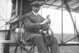 Curtiss sitting on his plane